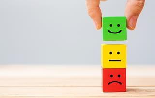 emotion-face-symbol-on-wooden-cube-blocks-service